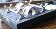 Knife rests and Napkin rings in own box. - View large image and details.